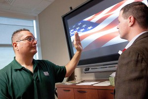 Diego F. Hernandez, PsyD (left), a licensed clinical psychologist, demonstrates Accelerated Resolution Therapy, as veteran Brian Anderson follows his hand movements. (Credit: University of South Florida)