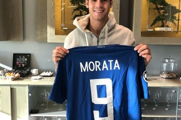 Alvaro Morata holds up his signed jersey