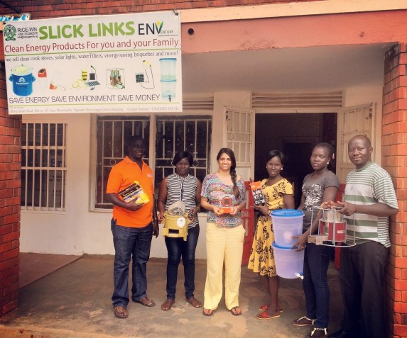 ENVenture team visiting RICE team at their internet cafe and clean energy business. Liberia and Esther are second and third from the right.