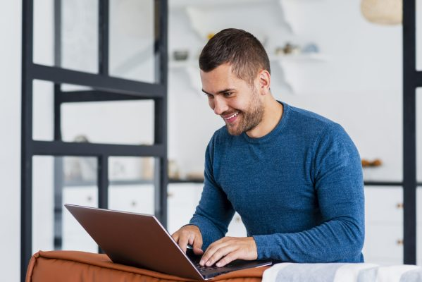 Man working from home using a laptop