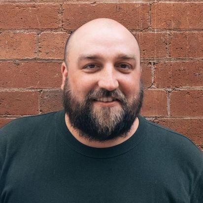 Caspian Turner - a bald man with a beard