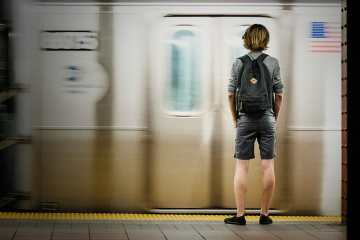 Someone waiting for the subway - hire someone with autism spectrum disorder