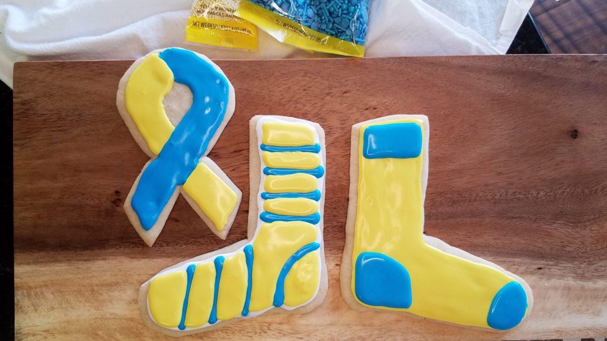 yellow and blue sugar cookies: sock and awareness ribbon