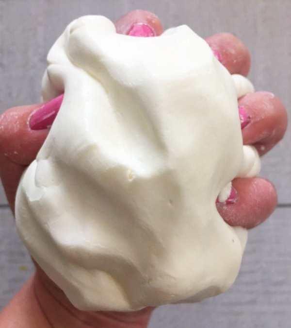 hand holding white dough