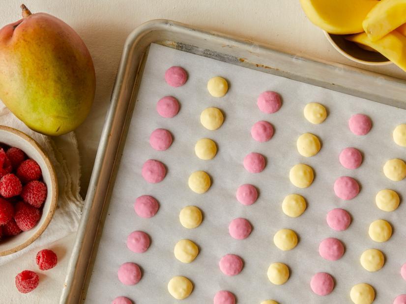 frozen yogurt dots on a baking sheet