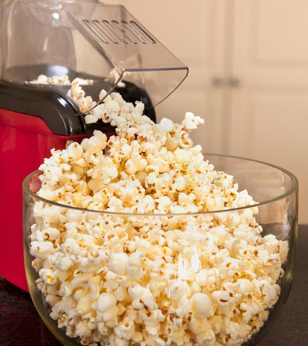popcorn coming out of popper into bowl