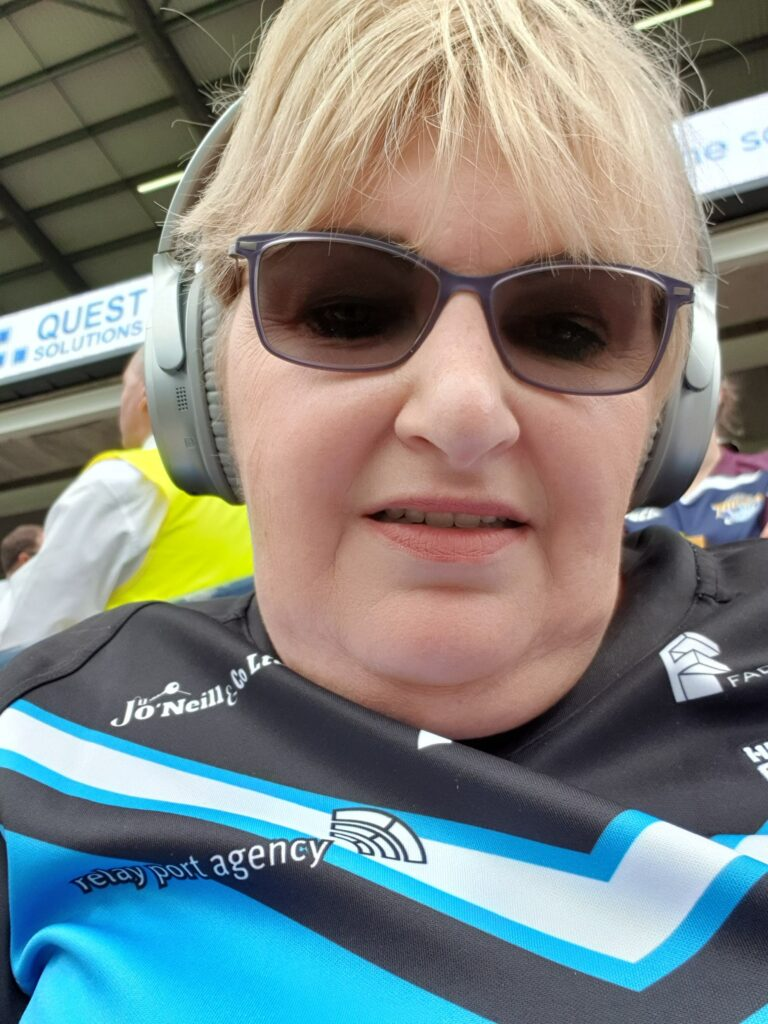Me with Bose noise cancelling headphones on wearing a Hull FC shirt