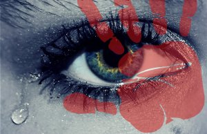 Picture of an eye close up with green eye and red colour depicting tears