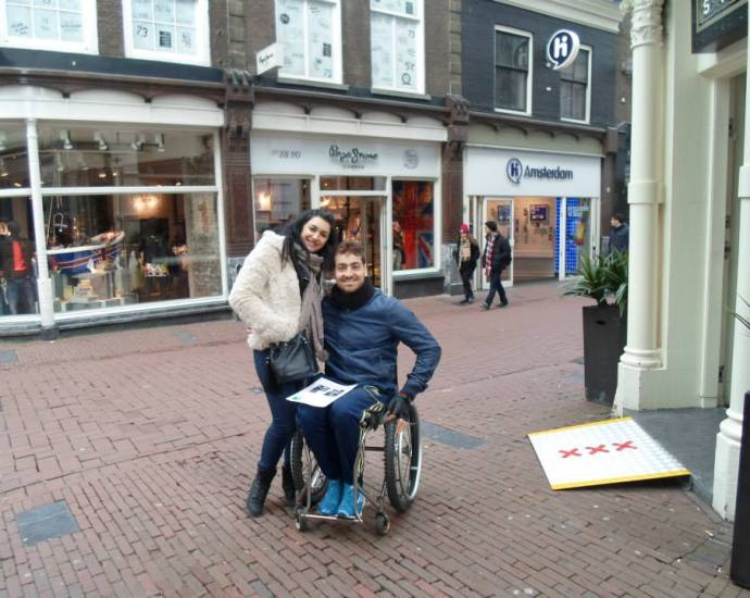 tourist in a wheelchair in Amsterdam