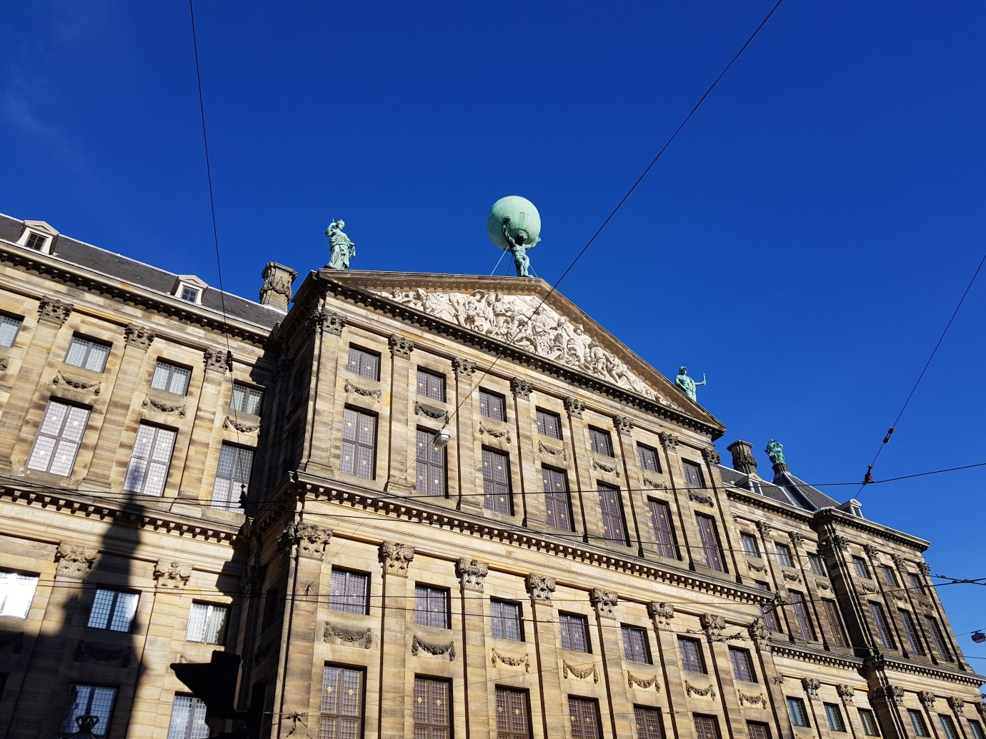 Atlas statue on top of royal palace amsterdam