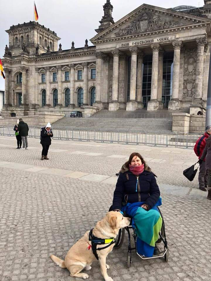 Sandra with her assistance dog in Berlin Germany