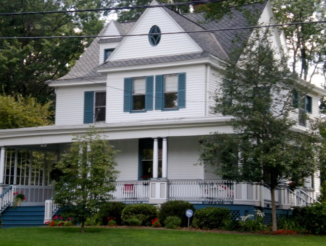 White Country House With Wrap Around Porch