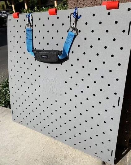 Beach Trax panels with carrying strap attached to top with carabiners.