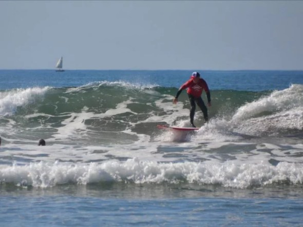 An adaptive athlete surfing.