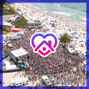 Arial image of a large crowd of people at the beach for the BRO-AM event,
