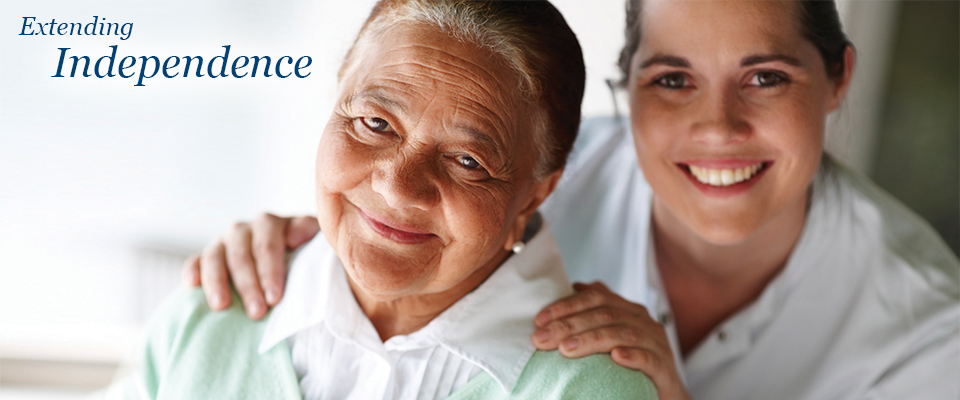 Smiling senior woman with health care provider