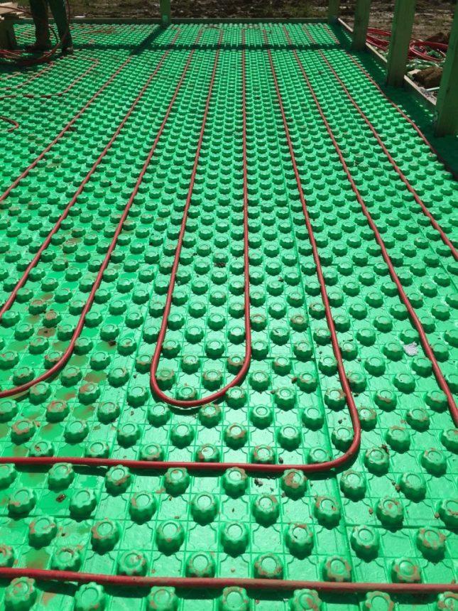 Radiant heat system using PEX tubing placed in Crete Heat insulation
