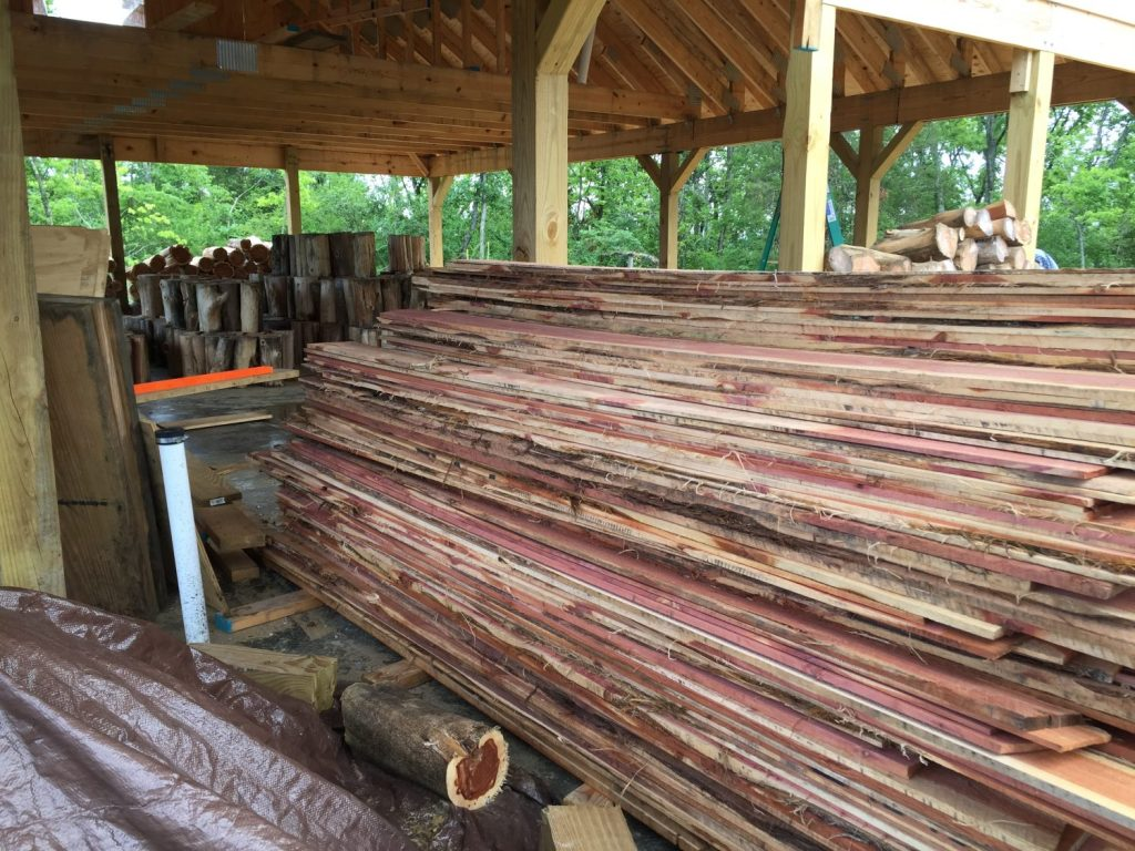 Rough cedar lumber can be easily used as lap siding on a home with minimal expense if you know where to find it!