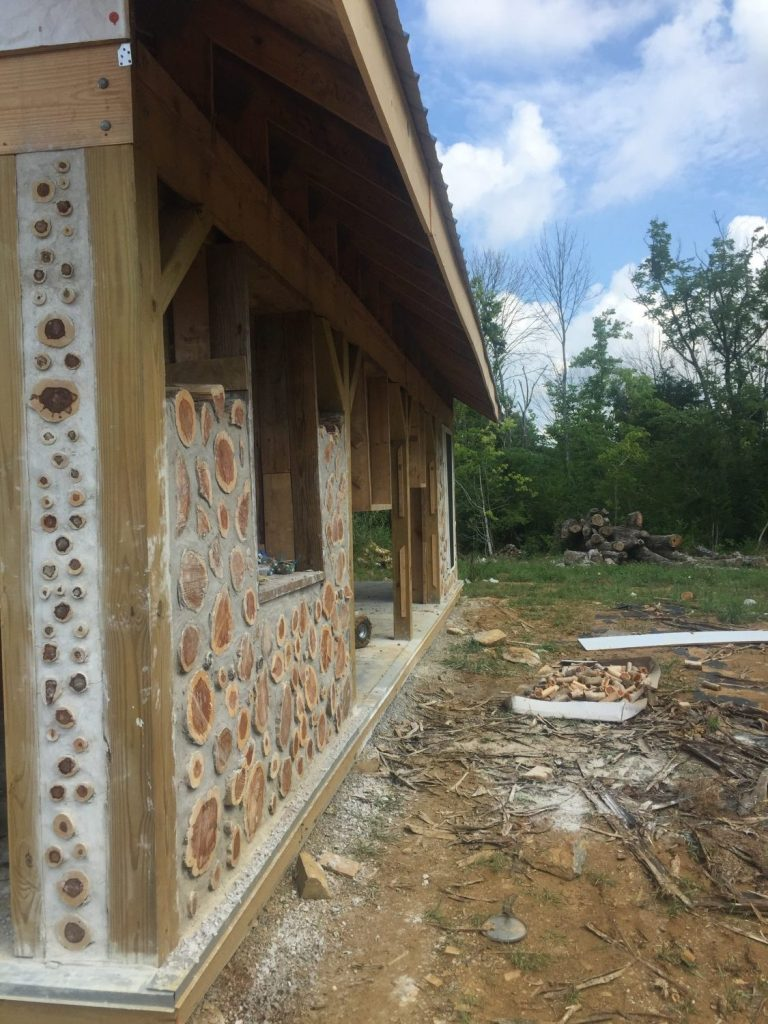 """Looking down a cordwood wall in progress -- it gives you some sense of how the """"fake"""" column will look with the walls."""