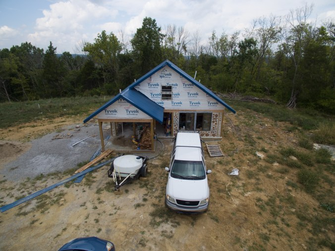 The front of our cordwood house, still in progress - accidentalhippies.com