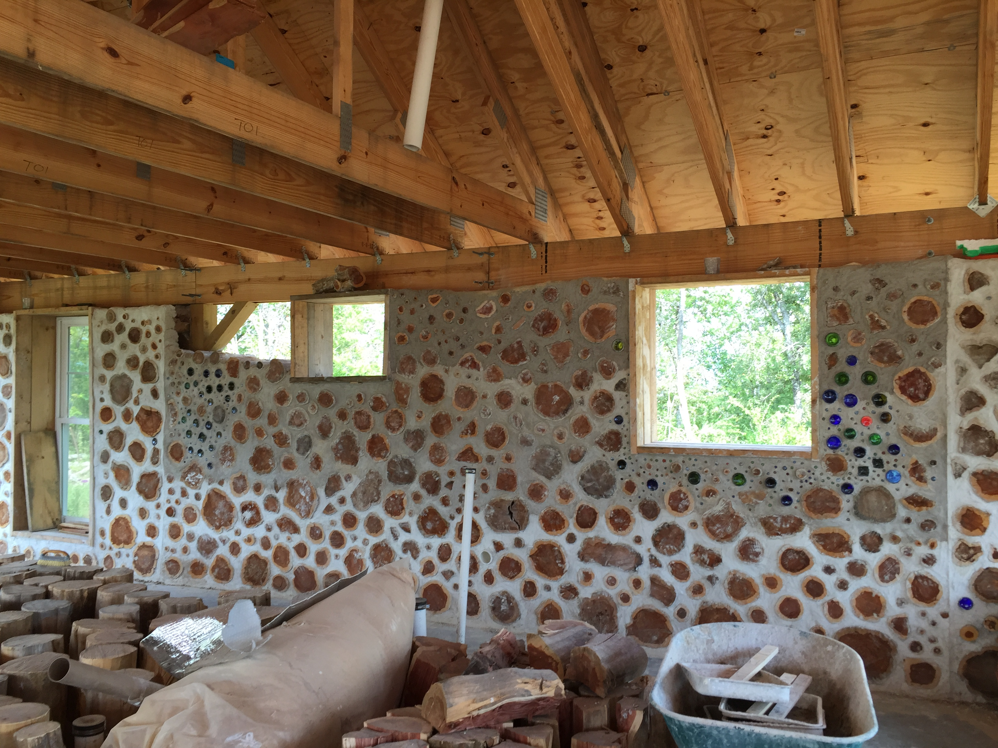Interior cordwood wall in progress - at Accidental Hippies