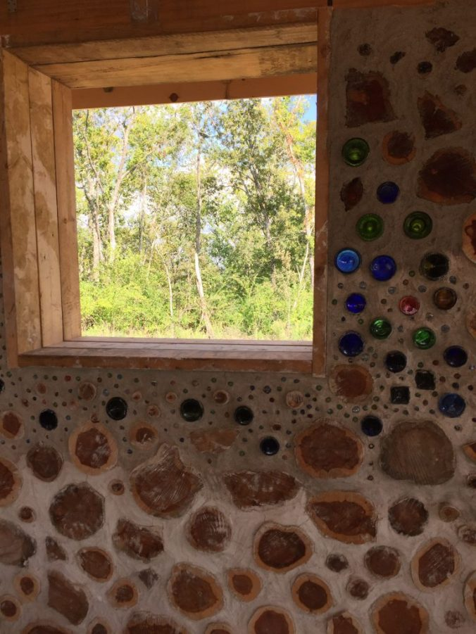 Bottles and marbles in a cordwood wall - at Accidental Hippies