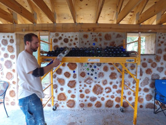 Stacking bottle bricks for use in cordwood walls - accidentalhippies.com