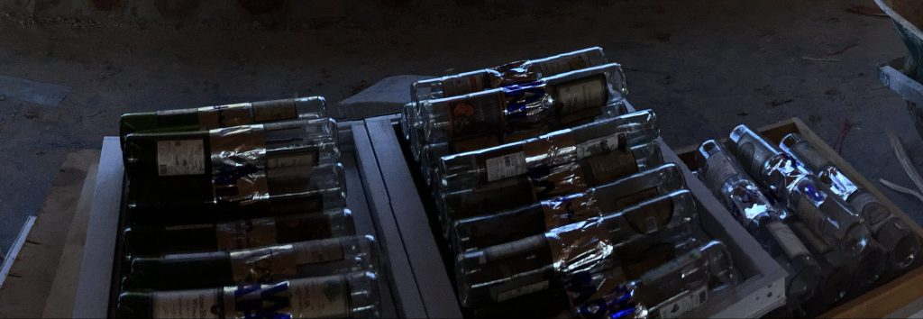 Here are a bunch of bottle bricks secured with flashing tape and ready to go into a cordwood wall