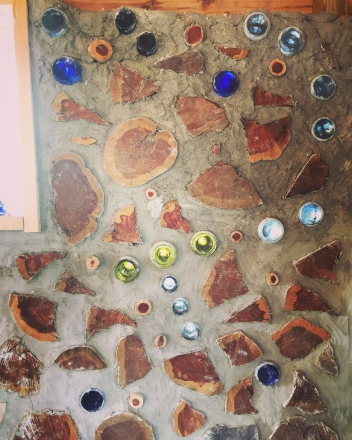 You can use bottles in a cordwood wall to make constellations. Here is the constellation Orion. The mortar at the top still needs to be smoothed out.