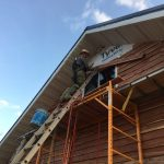 Learn how we DIYed our own cedar lap siding on the cheap!