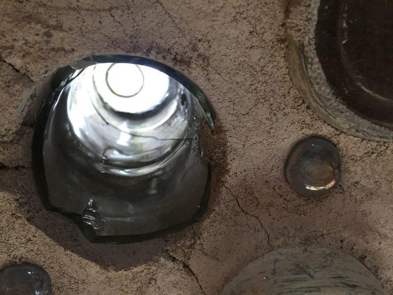 Broken bottle inside a bottle wall. Learn how we fixed it.