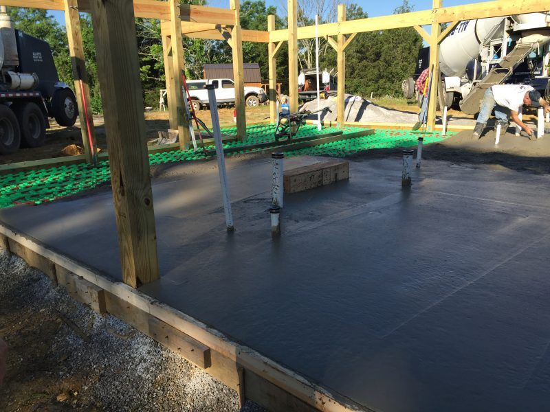 Pouring the concrete slab for a cordwood house