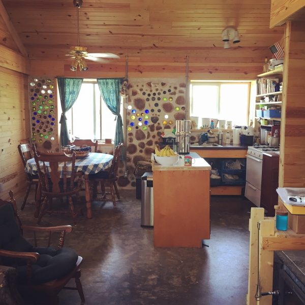 The kitchen in our cordwood house. Find out how we built it with our own hands here. #cordwood #homesteading #offgrid