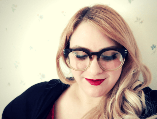 hipster glasses paired with red lipstick and a red velvet top. Oversized plastic hipster eyeglasses frame in brown ombre