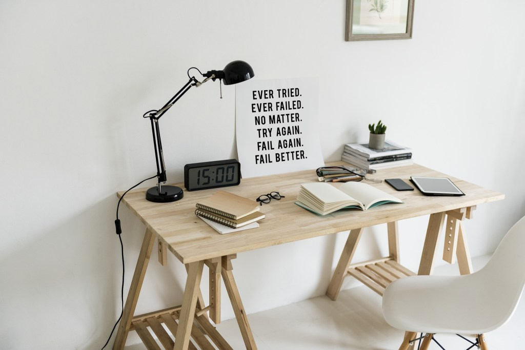 """No More Excuses - desk space with a white chair, black lamp, some books and a little post that says """"Ever Failed. Ever tried. No matter. Try again. Fail again. Fail better"""" (which I'm not really sure is a bit lame or kind of cool)"""