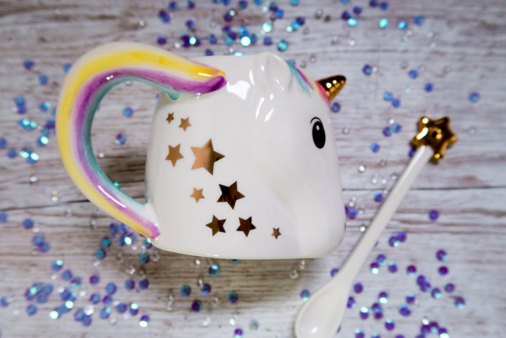 Unicorn ceramic cup and stirrer with a sequin background for the tween girls' gift guide