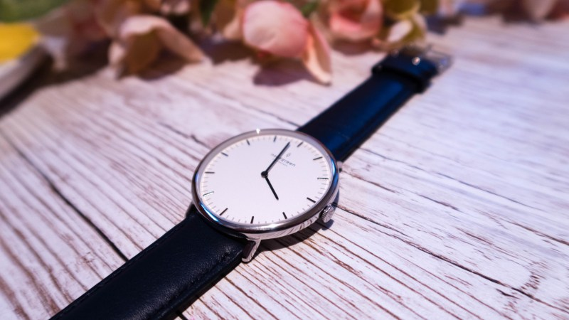 Nordgreen Native minimalist ladies watch up close on which wood background