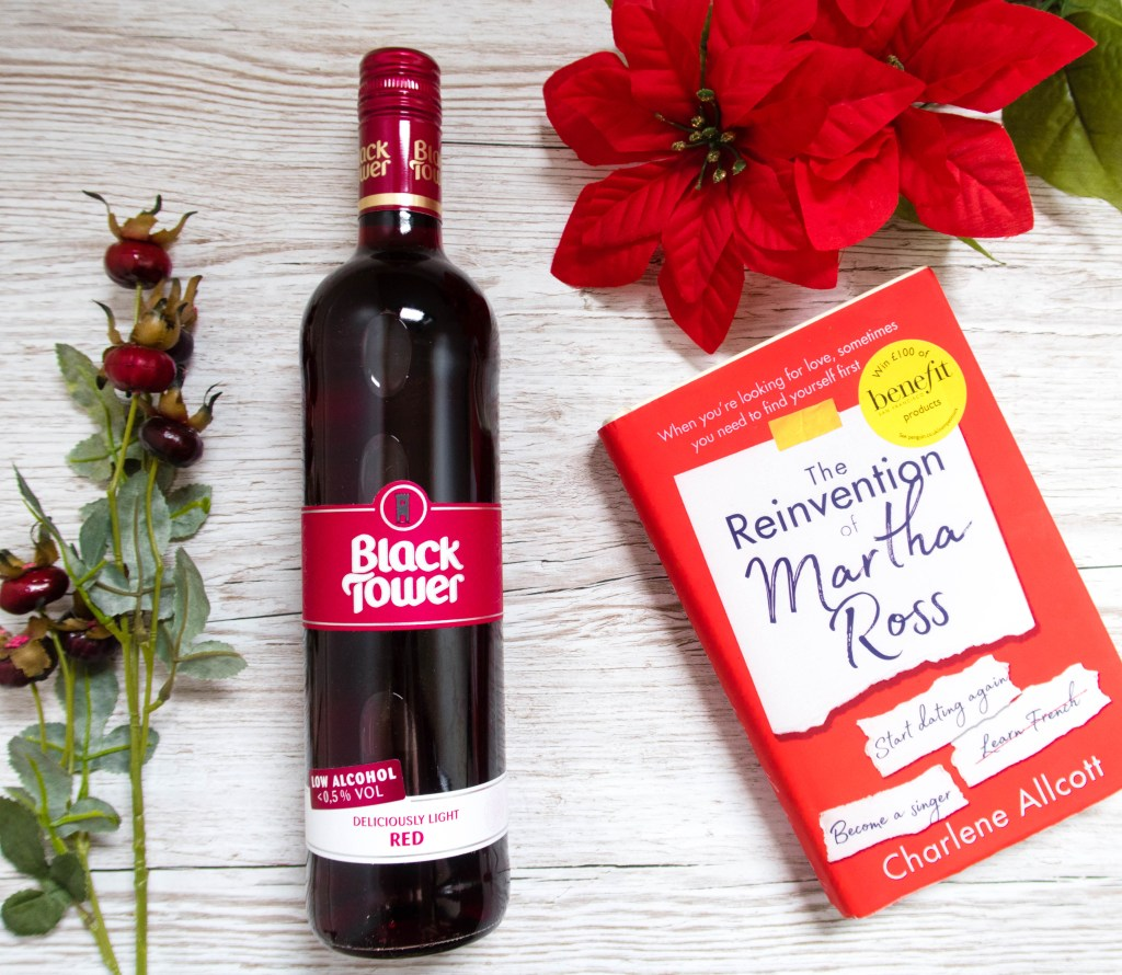 Slimming World Friendly Wine Black Tower Deliciously Light Red next to a red flower and book