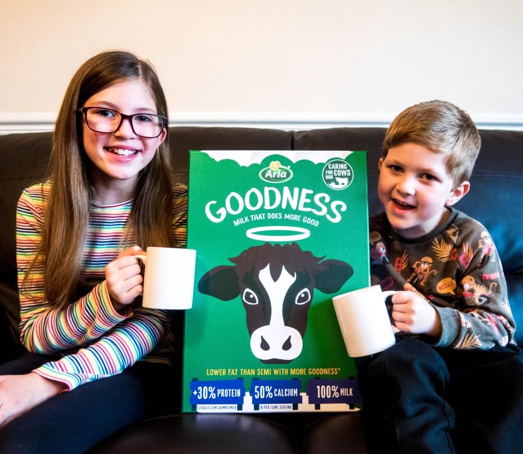 Greg and Emma next to a big carton of Arla Goodness