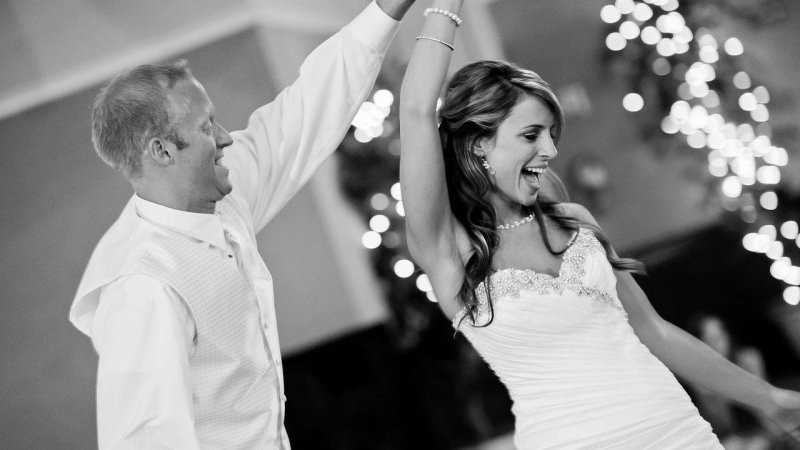 bride and groom dancing black and white photo
