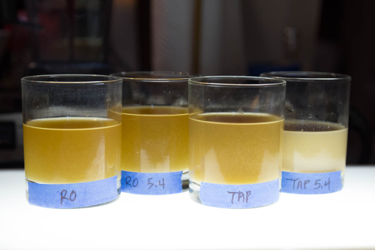 Lightbox comparison of filtered mash yields. Note varied volumes of wort, slight color differences and particularly the milky and low yield wort of the Tap adjusted to 4.2