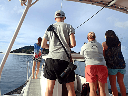 image-of-people-taking-photos-on-a-boat-in-palawan-philippines