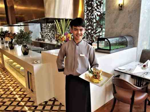 image-of-bangkok-restaurant-waiter-serving-thai-food