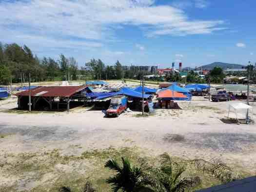 image-of-vendors-setting-up-stalls-at-nai-yang-market-in-phuket-thailand