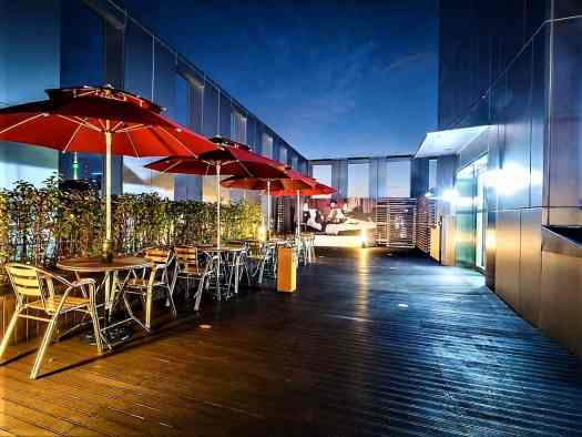 Rooftop garden serves food and beverage at Travelodge Dongdaemun with views of downtown Seoul Korea