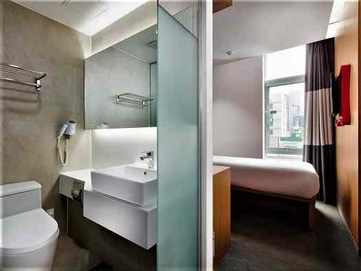 standard single hotel guest rooms at travelodge dongdaemun in seoul korea have single beds and private bathrooms