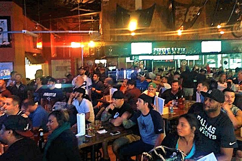 Fans rooting for Dallas Cowboys at Carollton Chop Shop sports watch bar