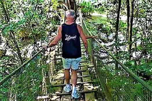 king-for-a-day-crossing-a-bridge-into-the-headhunters-village