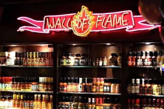 wall-of-flame-hot-sauce-display-at-coyote-in-hong-kong
