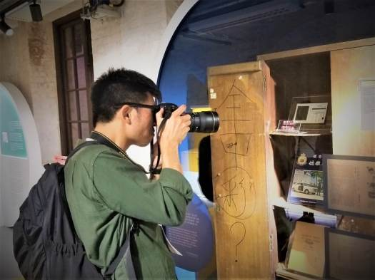photographer-photographing-tai-kwun-101-exhibit